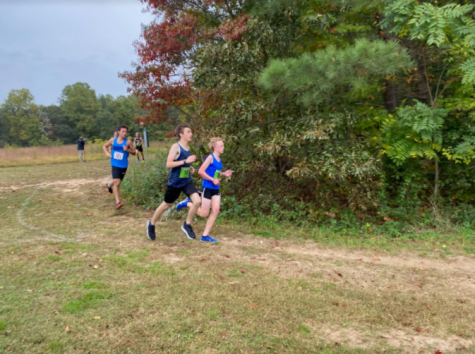 Sophomore Mason Hughes, Junior Mark Vorster, and Junior Will Taliaferro compete in a club meet at Pole Green Park. Photo courtesy of: Mason Hughes