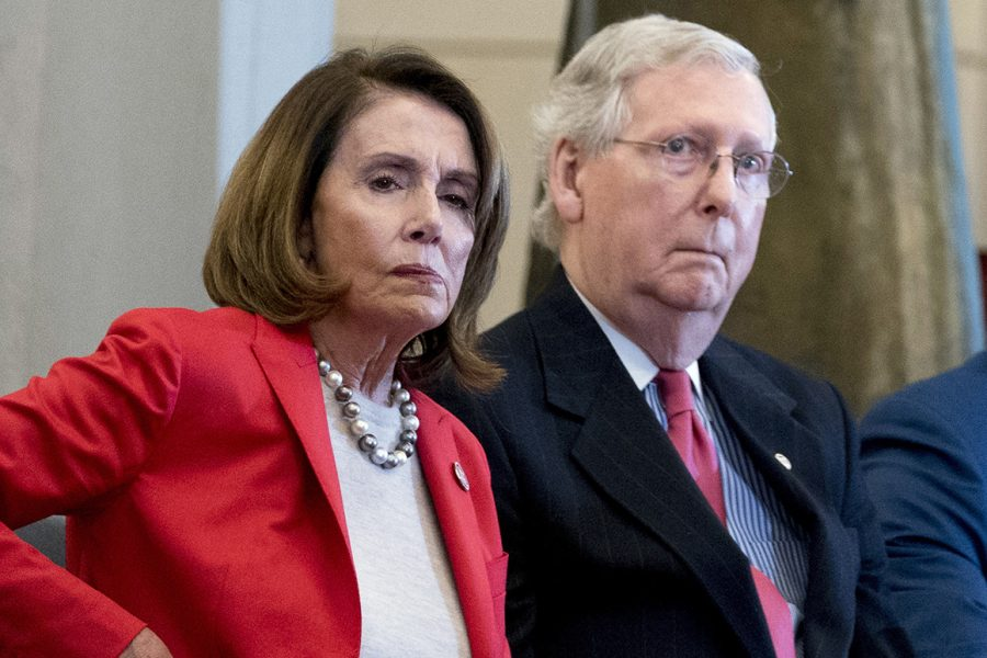 FILE+-+In+this+March+21%2C+2018%2C+file+photo+Nancy+Pelosi+of+Calif.%2C++and+Senate+Majority+Leader+Mitch+McConnell+of+Ky.%2C+attend+a+Congressional+Gold+Medal+Ceremony+honoring+the+Office+of+Strategic+Services+in+Emancipation+Hall+on+Capitol+Hill+in+Washington.+Pelosi+and+McConnell+are+coming+together+to+see+if+a+deal+can+be+made+to+stop+billions+of+dollars+in+government+spending+cuts.+Failure+to+reach+an+agreement+would+usher+in+cuts+to+the+Pentagon+and+domestic+programs+of+%24125+billion+next+year+_+a+10+percent+drop+from+current+levels.%28AP+Photo%2FAndrew+Harnik%2C+File%29