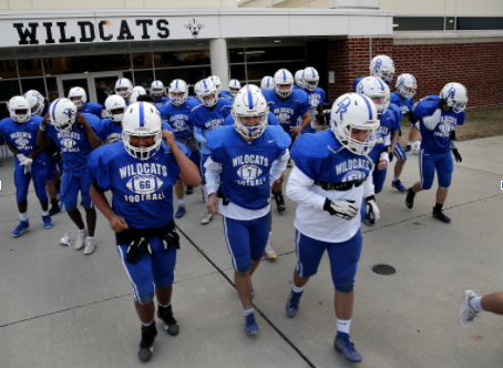 The Varsity Football team runs out to practice during the 2019-2020 season.