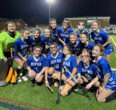 The field hockey team celebrates after a 7-0 win against Freeman