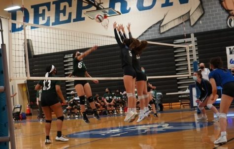 The girls volleyball team competes.
