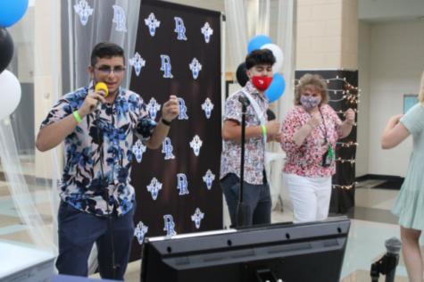 Seniors Sam Soltanian sings karaoke at the event.