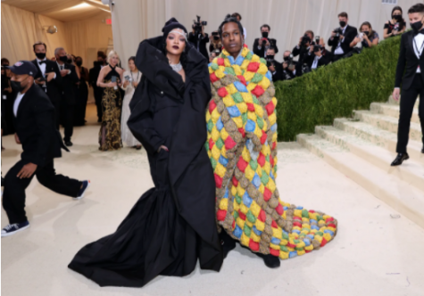 Music artists, Rihanna and her significant other, A$AP Rocky, attended the Gala together. Rihanna was dressed in a Balenciaga black overcoat with extravagant jewelry. She also wore a matching black hat from Stephen Jones Millinery to complete the look. Rocky wore a cape-like quilt by Eli Russell Linnetz. Rihanna's dazzling outfit was definitely a statement piece; I loved it personally. However, A$AP Rocky's was quite tacky. His look was very different from normal outfits which is a positive, but I don't think this was the best outfit. The reasoning behind this would be the color differences and it could be considered as somewhat of an eyesore. I would wear Rihanna's outfit and tear Rocky's.